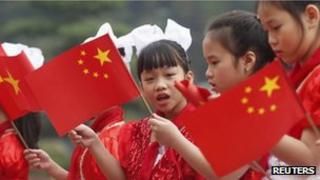 Vietnamese children waving the Chinese flag