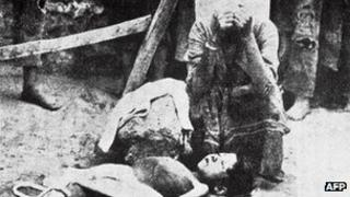 An Armenian woman mourns a dead boy during the deportations in 1915