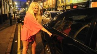 Girl getting into taxi