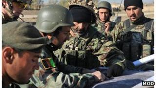 Afghan soldiers studying a map