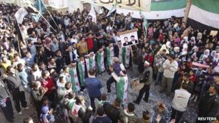 "Demonstrators protesting against Syria""s President Bashar al-Assad gather during a march through the streets after Friday prayers in Baba Amro in Homs December 16, 2011."