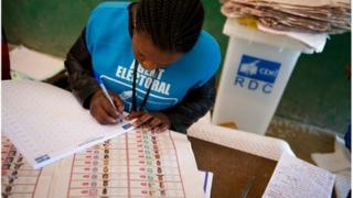 An election official at the Twalemishe school polling station begins noting parliamentary candidates for the results sheet in DR Congo's second city of Lubumbashi on 29 November 2011.