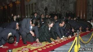North Koreans mourn their leader in Pyongyang on 21 December 2011
