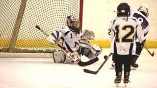 Boys in ice hockey action