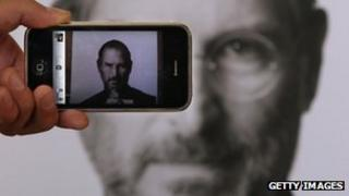 iPhone taking a picture of Apple founder Steve Jobs