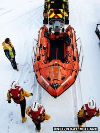 Lifeboat launch in snow