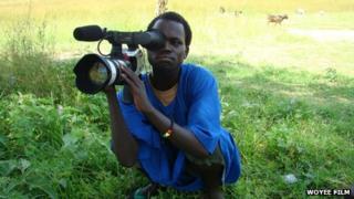 A Woyee member filming