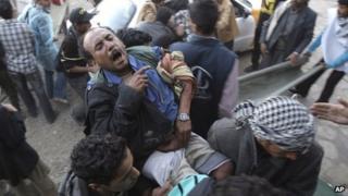Injured man in Sanaa, 24 Dec