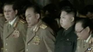 Kim Jong-un (2nd right) and Chang Song-taek (far left)