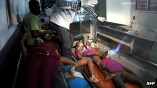Dead bodies of victims are transported by ambulance after the boat in they were traveling on capsized in Pulicat Lake, about 60 km from the South Indian city of Chennai on December 25, 2011