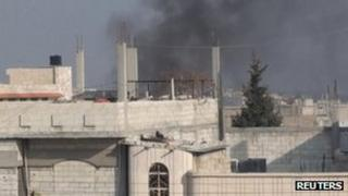 Smoke rises from an area near Homs. Photo: December 2011
