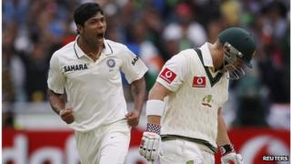 """India""""s Umesh Yadav (L) celebrates taking the wicket of Australia""""s David Warner (R) during the first day of the first cricket test match, at the Melbourne Cricket Ground December 26, 2011"""