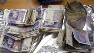 Bundles of £20 notes wrapped in silver foil