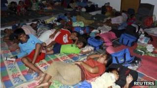 Residents in an evacuation shelters near Mount Gamalama on 5 December 2011