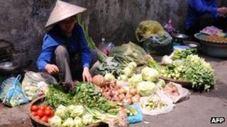 Vendor selling vegetables in Vietnam