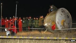 China's unmanned Shenzhou-8 returned to Earth, after completing two space dockings last month