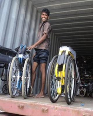 Consignment of PhysioNet charity wheelchairs being unloaded in Sri Lanka