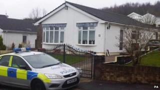 A police car outside the couple's bungalow