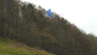 A paraglider got stuck in a tree after take off on Frocester Hill