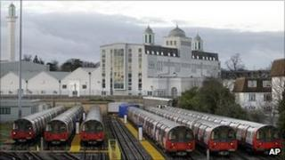 Tube trains sit at a depot in Morden, south London