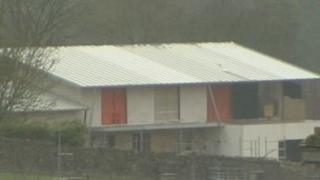 """House that has been described as a """"cowshed"""""""