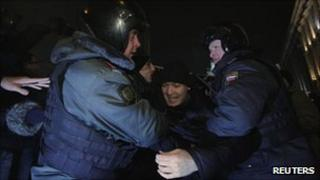Police officers detain an activist in Moscow, 31 December 2011