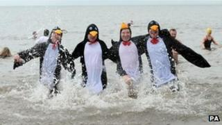 Dippers dressed as penguins at Whitley Bay