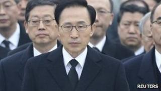 Lee Myung-bak (centre) pictured at the National Cemetery in Seoul on 1 January 2012