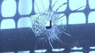 damage caused by gunshot at house in distillery street