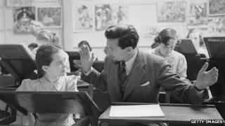 Cartoonist Ronald Searle, creator of the St Trinian's stories, visits an art class at Acton Reynold girls school near Shrewsbury. Original Publication: Picture Post - 1950 (Photo by Kurt Hutton/Picture Post/Getty Images)