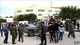 Libyans gunmen roam along Zawiyah Street in the Libyan capital Tripoli after a gunfight erupted.
