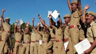 Tiger force members celebrate after finishing a special training course near Bangalore. Photo: Habib Beary