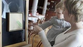 Visitors to the museum admire Andrzej Sobiepan's artwork
