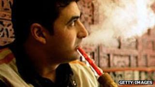 Man smoking shisha pipe