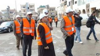 Arab League monitors check Al-Sabil area, in Daraa; photo provided by state news agency SANA