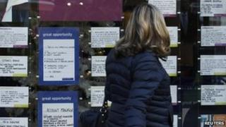 Woman looks at job adverts
