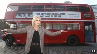 Joanna Lumley in front of double decker bus