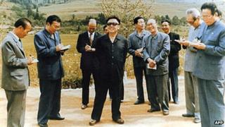 Kim Jong-il in 1999 with his inner circle