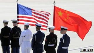 A colour guard of US and Chinese flags awaits the plane of China's President Hu Jintao at Andrews Air Force Base, Maryland, 12 April 2010