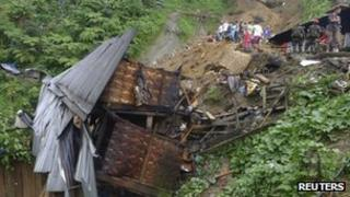 Shanties destroyed by a landslide in southern Philippines