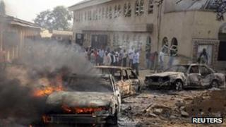 Burning car outside St Theresa Catholic Church at Madalla outside Abuja (25 Dec 2012)
