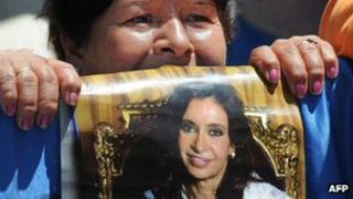 A supporter of Argentine President Cristina Fernandez de Kirchner waits with her poster outside the Austral Hospital in Pilar, Buenos Aires on Wednesday as she underwent surgery for thyroid cancer