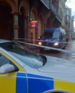 The robbery happened outside a branch of Santander in Belfast