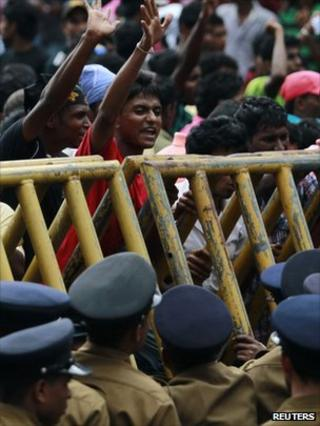 Students shout slogans to protest against a petrol bomb blast that damaged a memorial statue at the Sri Jayawardenepura University in Colombo January 5, 2012.