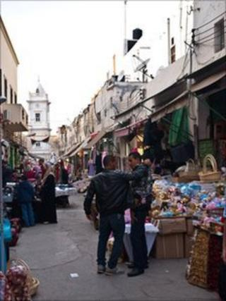 Shop owners at a market in central Tripoli