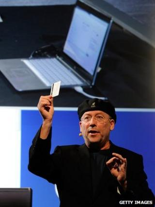 Intel's vice president Mooly Eden shows off the touch-less credit card reader at CES 2012