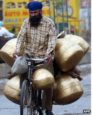 File photo of an Indian milk man returning home after his morning round in Amritsar (27 May 2008)