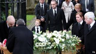 The family of Kerry McGregor, including her son Joshua and partner Dean Robertson at her funeral