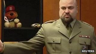 Col Mikolaj Przybyl asks reporters to leave before shooting himself. 10 Dec 2012
