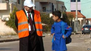 An Arab League monitor speaks with a Syrian pupil in Deraa, on 3 January 2012